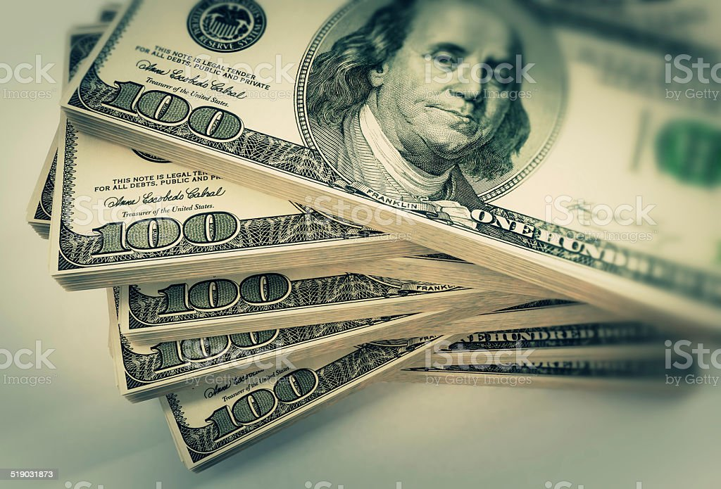One hundred USD bills stack stock photo