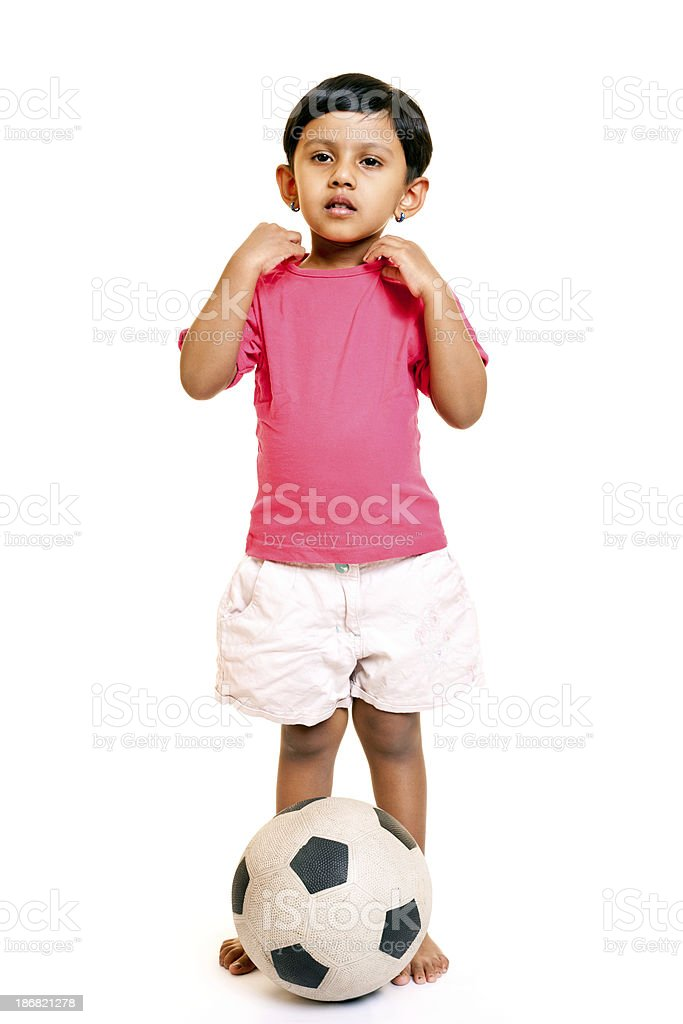 one indian girl standing with football Isolated on white royalty-free stock photo