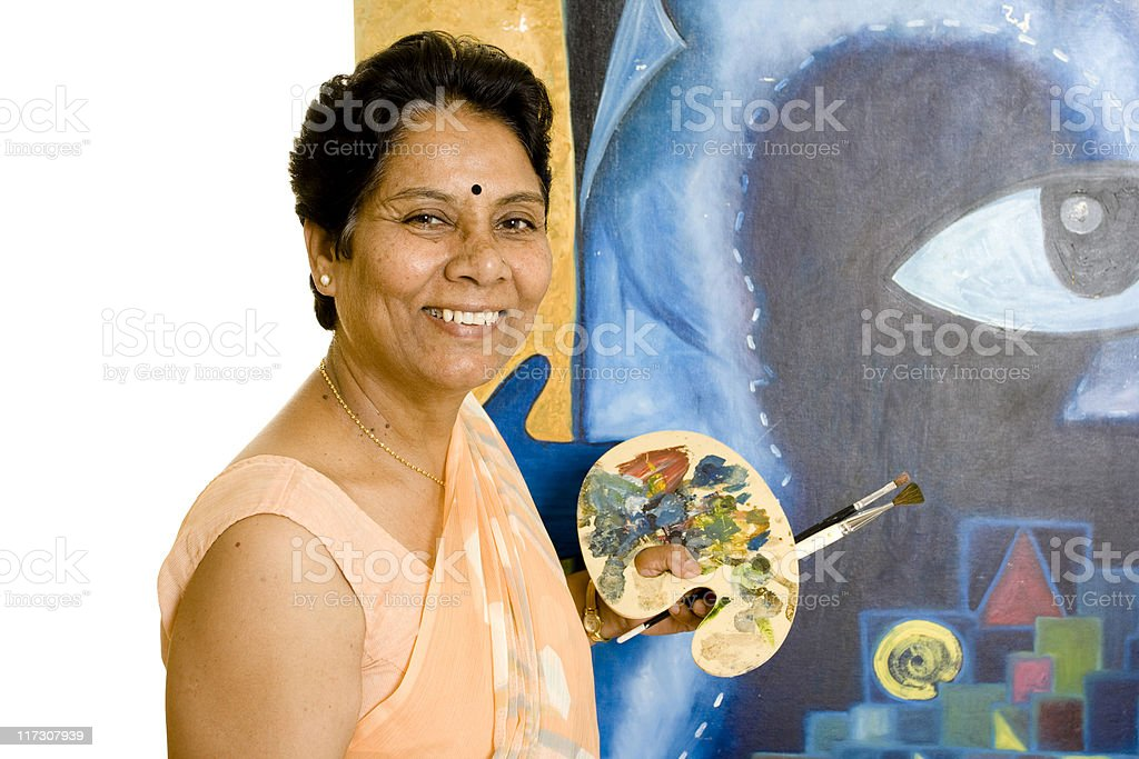 One Indian Senior Woman Artist Working on her Painting royalty-free stock photo