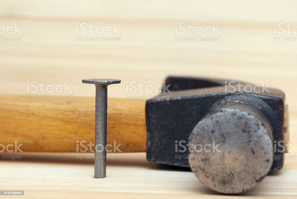 One iron nail and hammer royalty-free stock photo