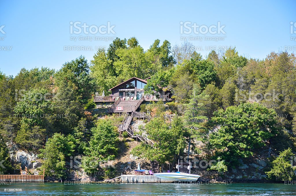 One Island with the white house in Thousand Islands Region stock photo