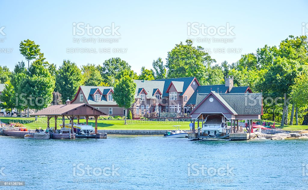 One Island with the white house with a white boat stock photo