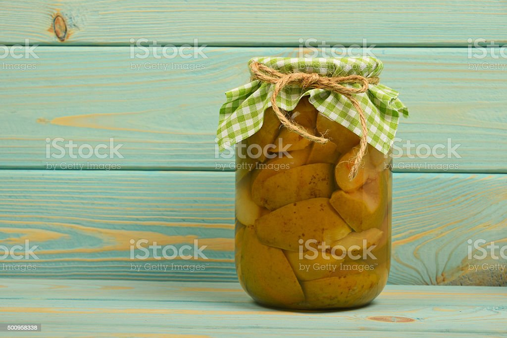 One jar of pear compote at blue vintage wood surface royalty-free stock photo
