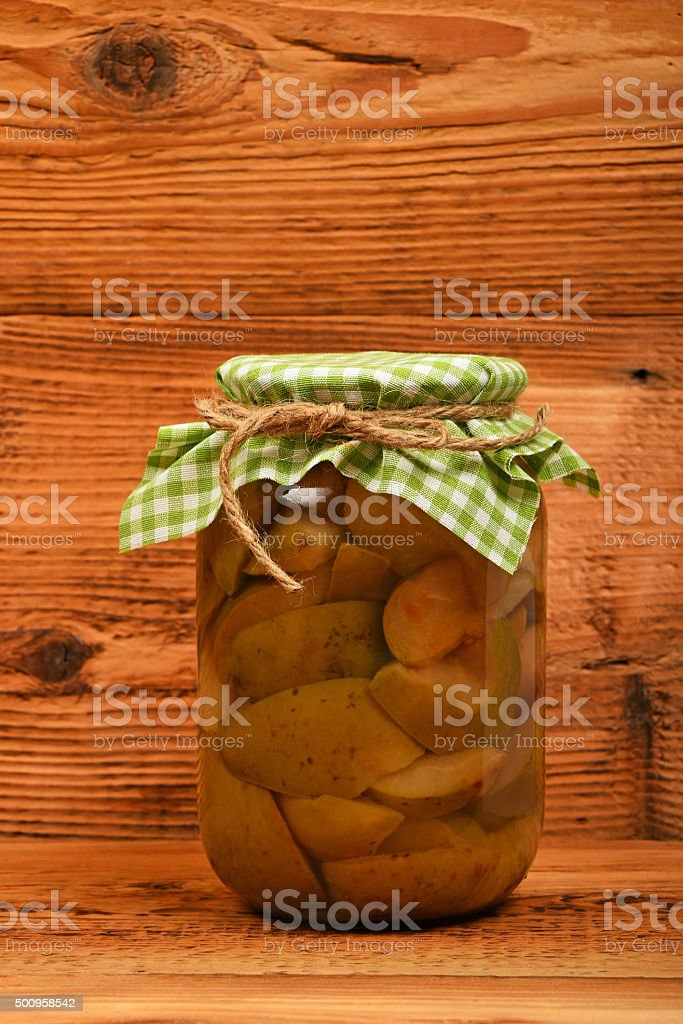 One jar of pear compote at brown vintage wood surface royalty-free stock photo