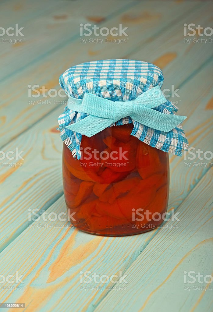 One jar of quince jam at blue vintage wood surface royalty-free stock photo