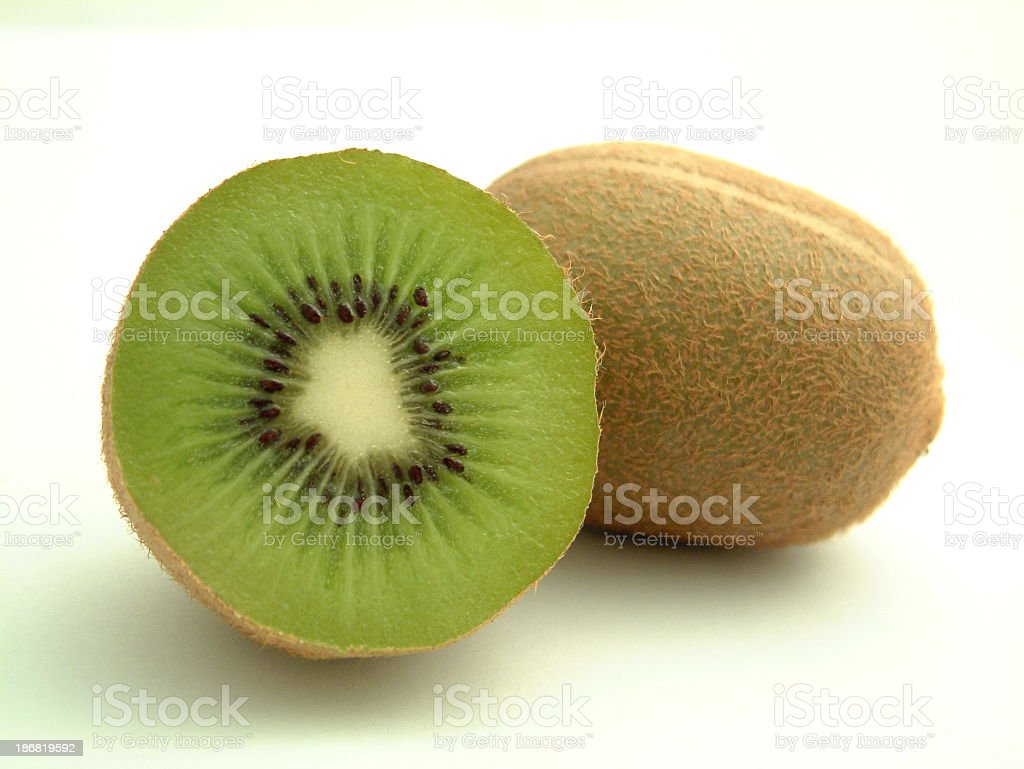 One kiwi fruit and another sliced in half royalty-free stock photo