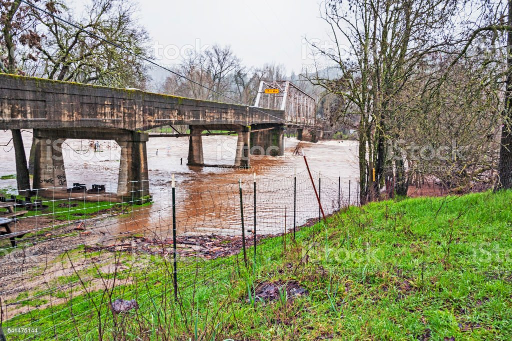 One Lane Country Bridge with Flooding American River in Coloma stock photo