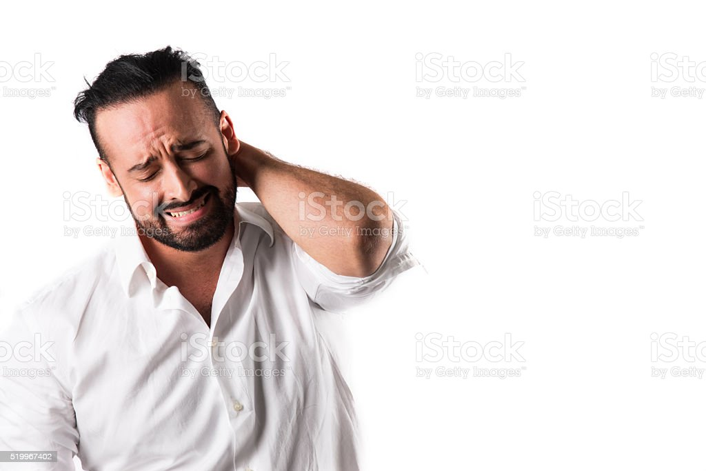 One Latino Male Who's Upset and Anxious or Physical Pain stock photo
