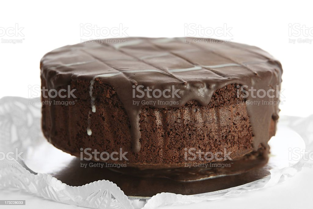One layer of a chocolate cake with chocolate icing stock photo