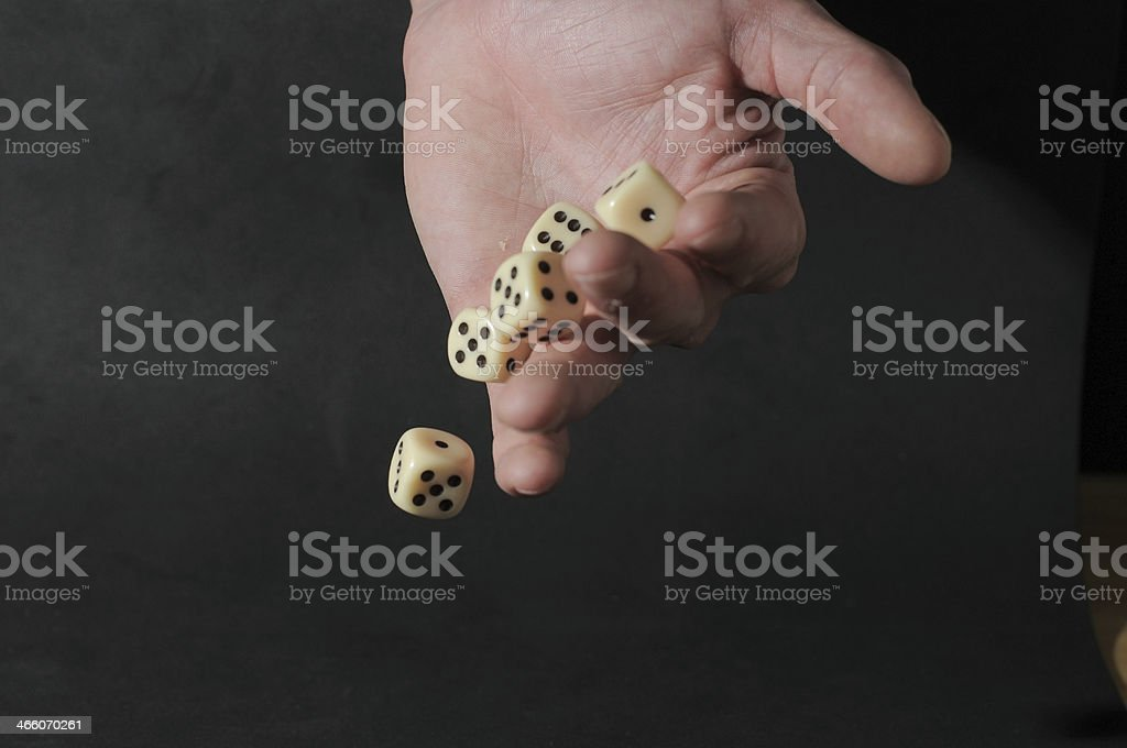 One Left Male Hand Playing Dice stock photo