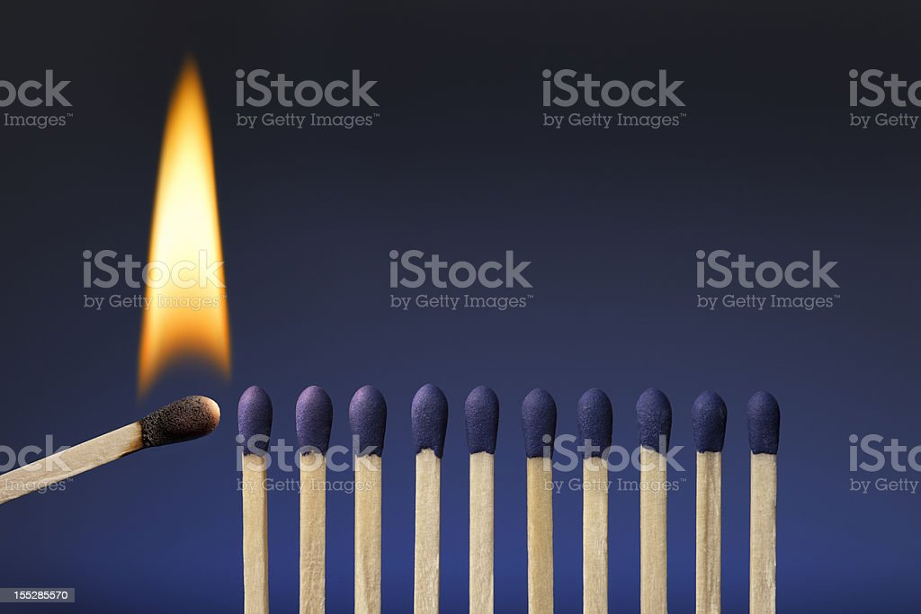 One Lit Match; Share Your Passion, Ignite It in Others stock photo