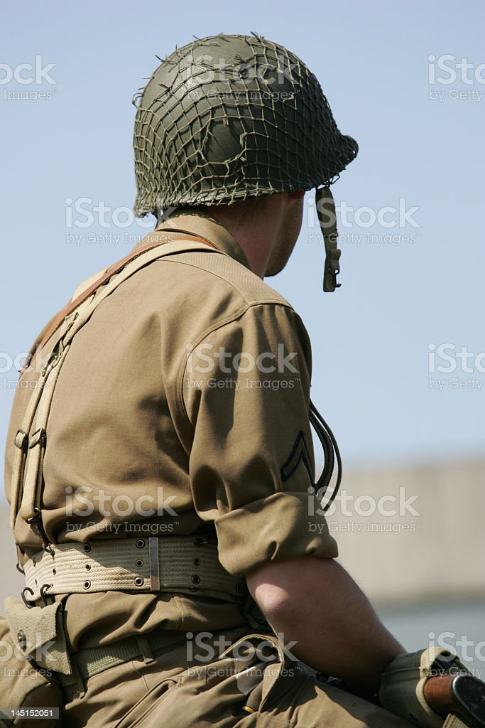 One lone soldier sitting at the beach  stock photo