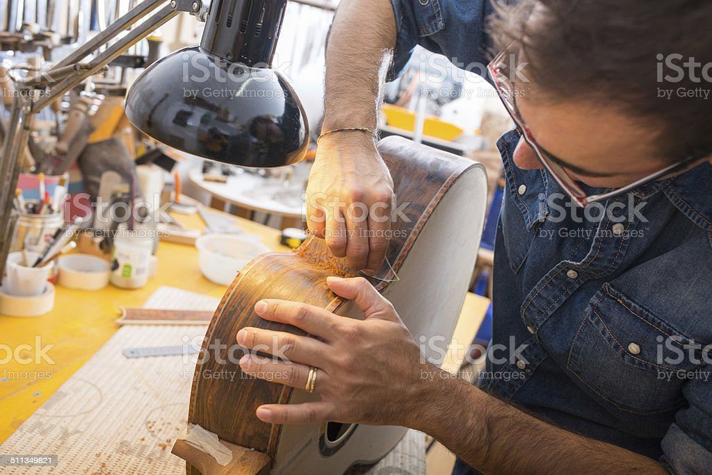 One luthier working on his next guitar stock photo