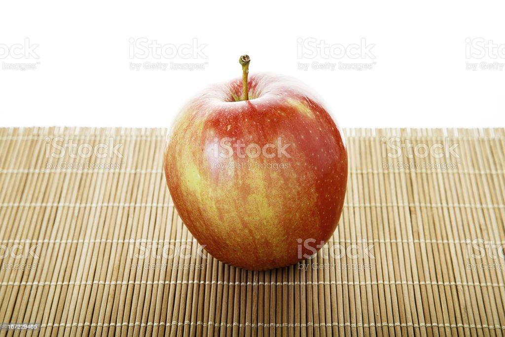 One Macintosh Apple on Mat stock photo