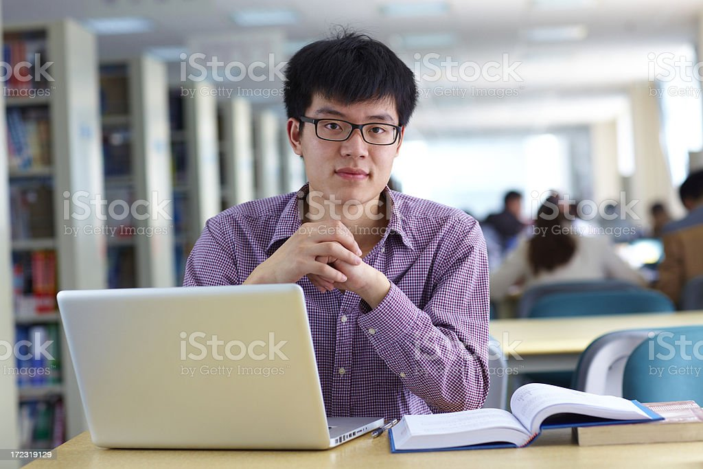 one male college student study in the library royalty-free stock photo