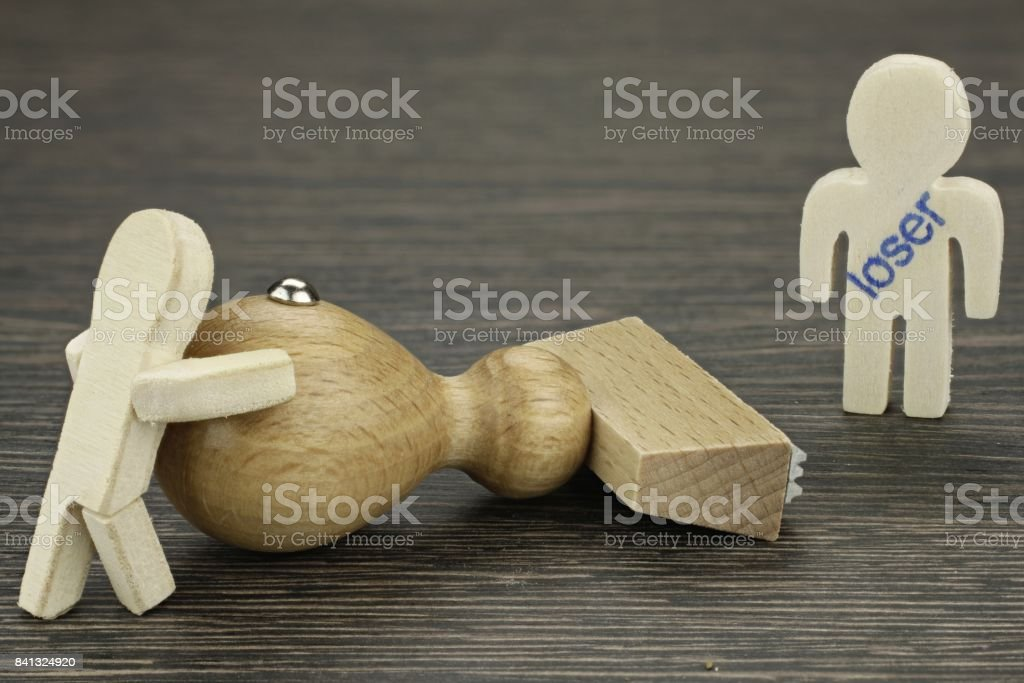 One male stamped as a loser by another stock photo