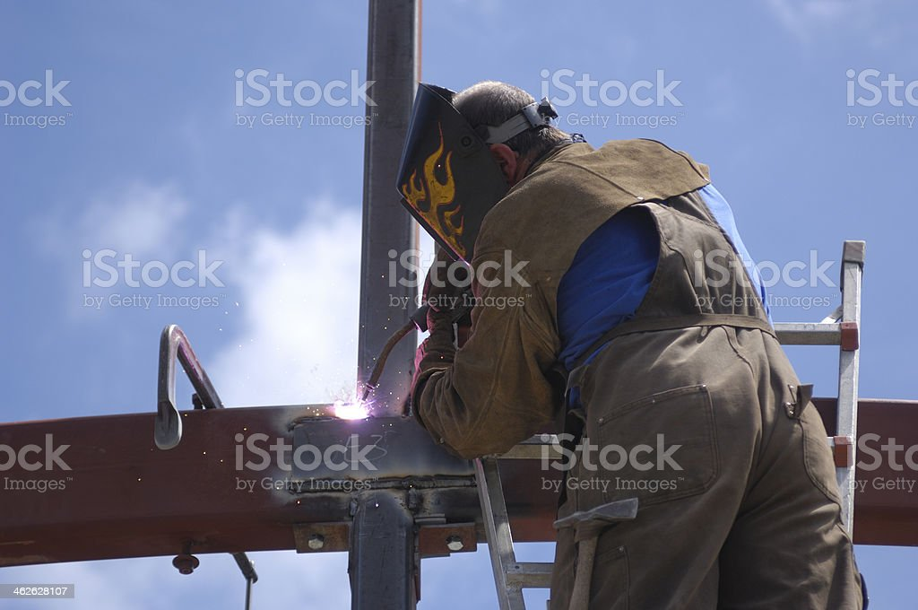 One Male Welder, on Ladder, Working With Steel royalty-free stock photo