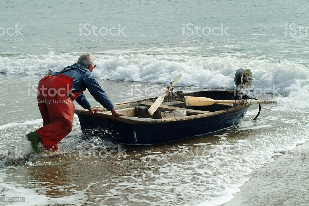 One man and his boat royalty-free stock photo