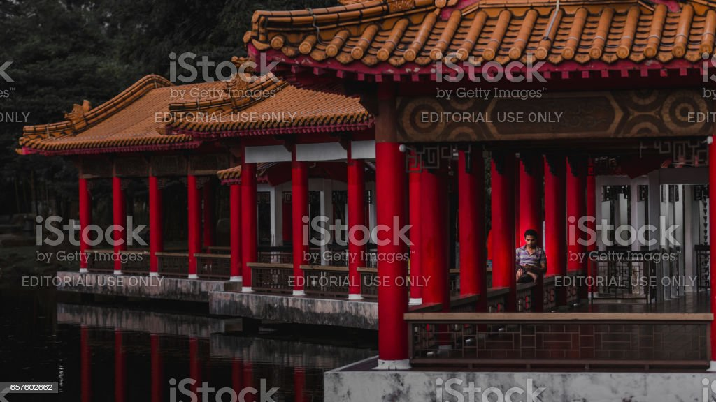 One man at the Tea House Pavilion stock photo