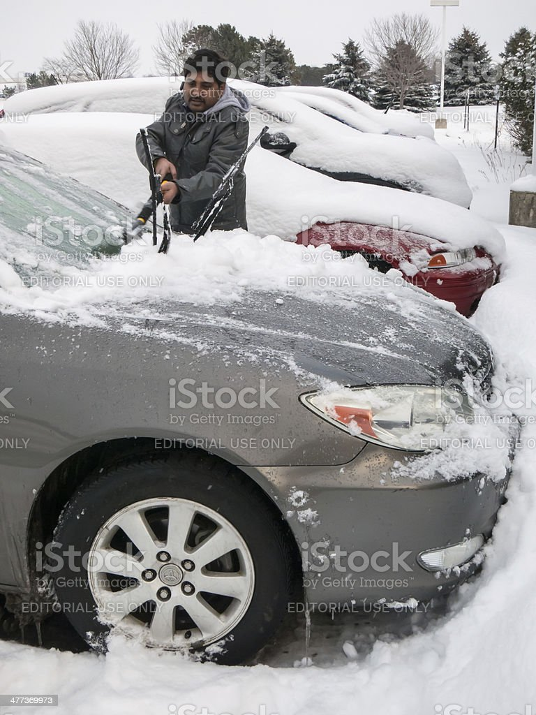One man cleaning snow stock photo