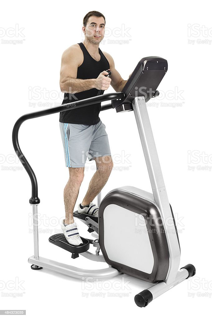 one man doing step machine exercise stock photo