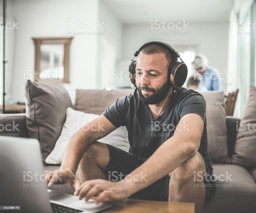 One man enjoys music stock photo