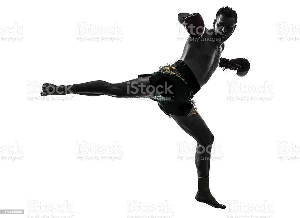 one man exercising thai boxing silhouette stock photo