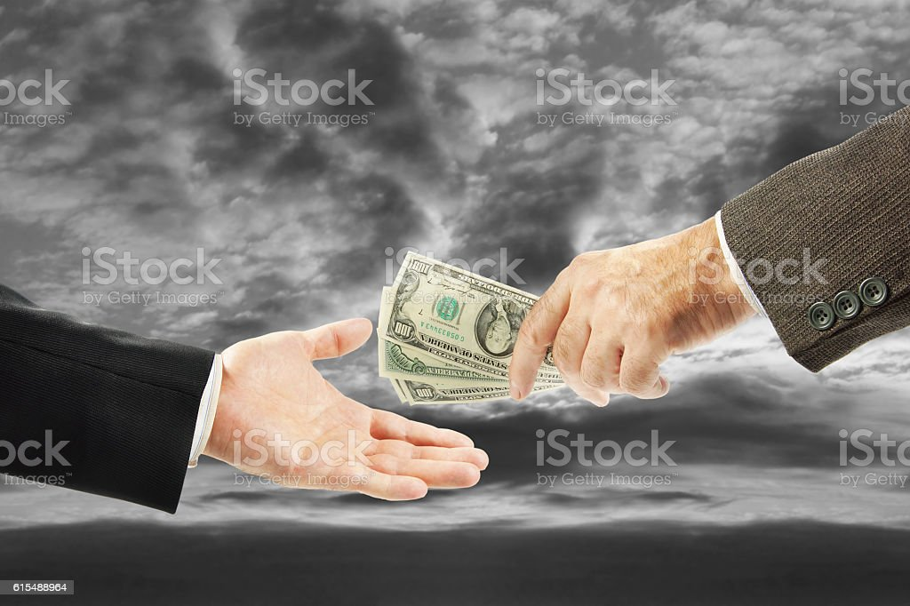 One man gives money to another. Concept of corruption stock photo