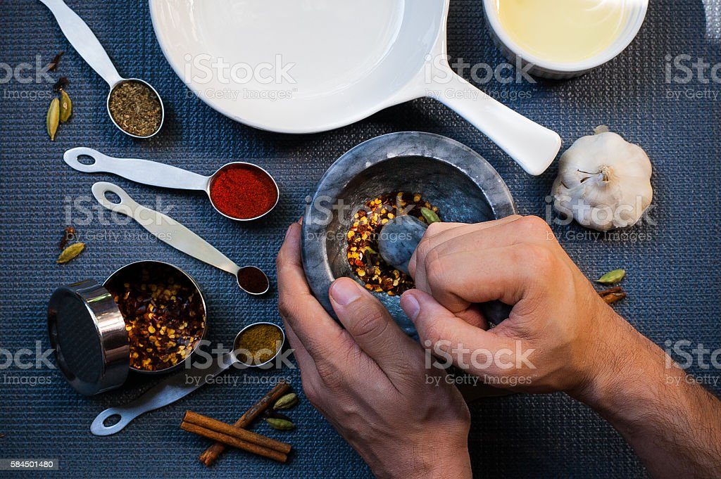 One man grinding Spices stock photo