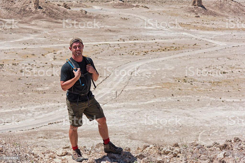 One Man Hiking Along a Desert Ridge stock photo