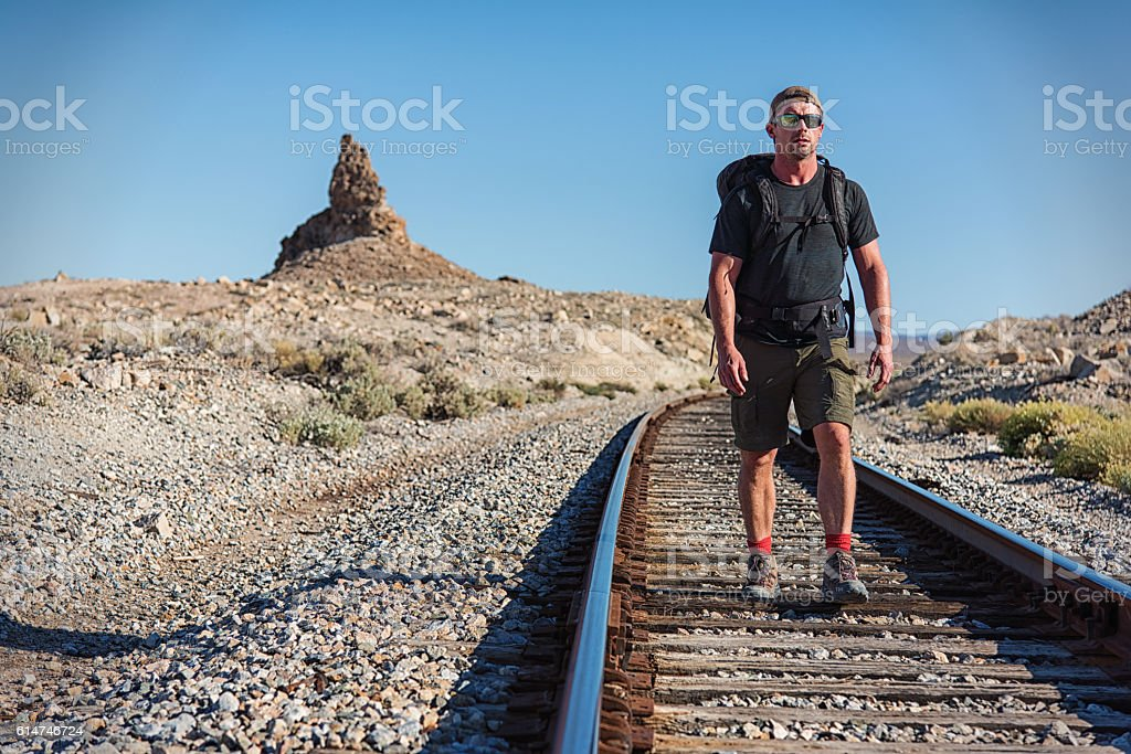 One Man Hiking on the Desert Tracks of Southern California stock photo