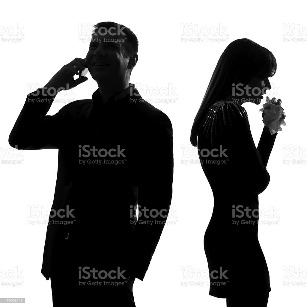 one man on phone turning his back to woman crying royalty-free stock photo