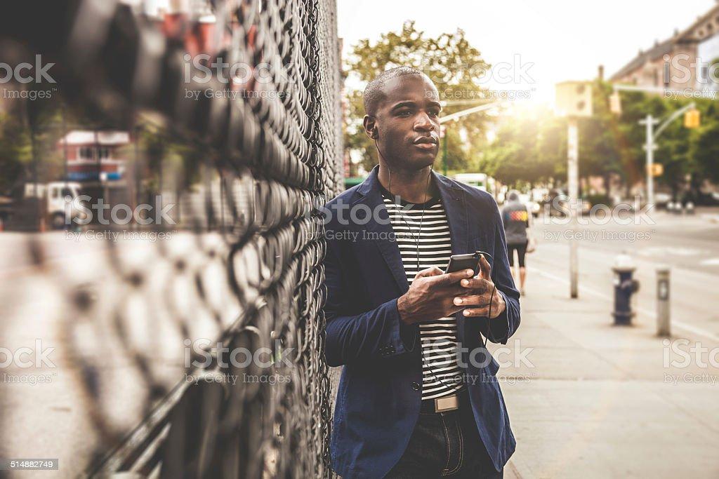 One man standing on the sidewalk stock photo