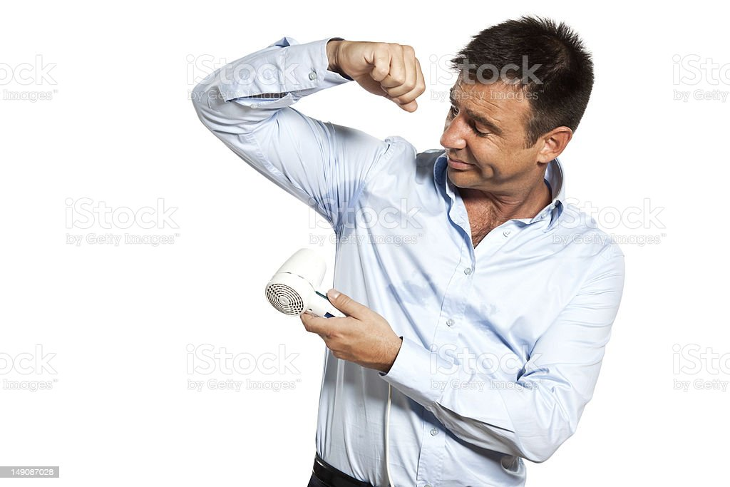 one man sweat stain perspire drying shirt stock photo