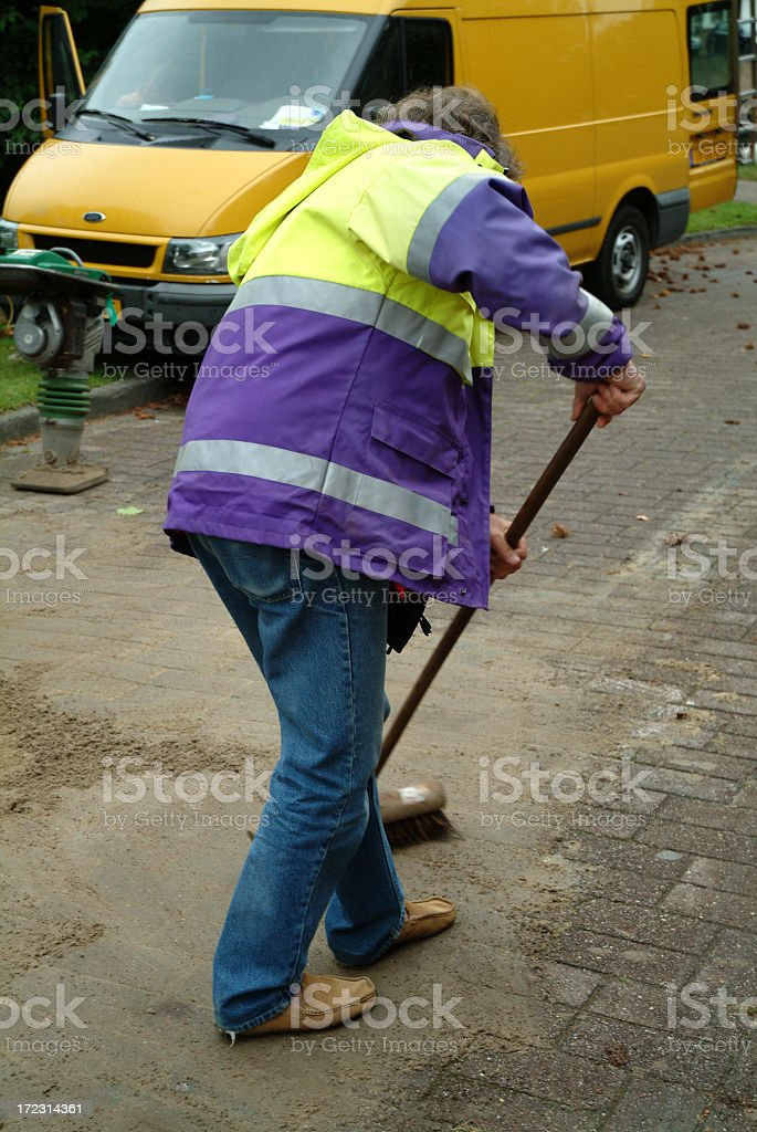 One man sweeping the street royalty-free stock photo