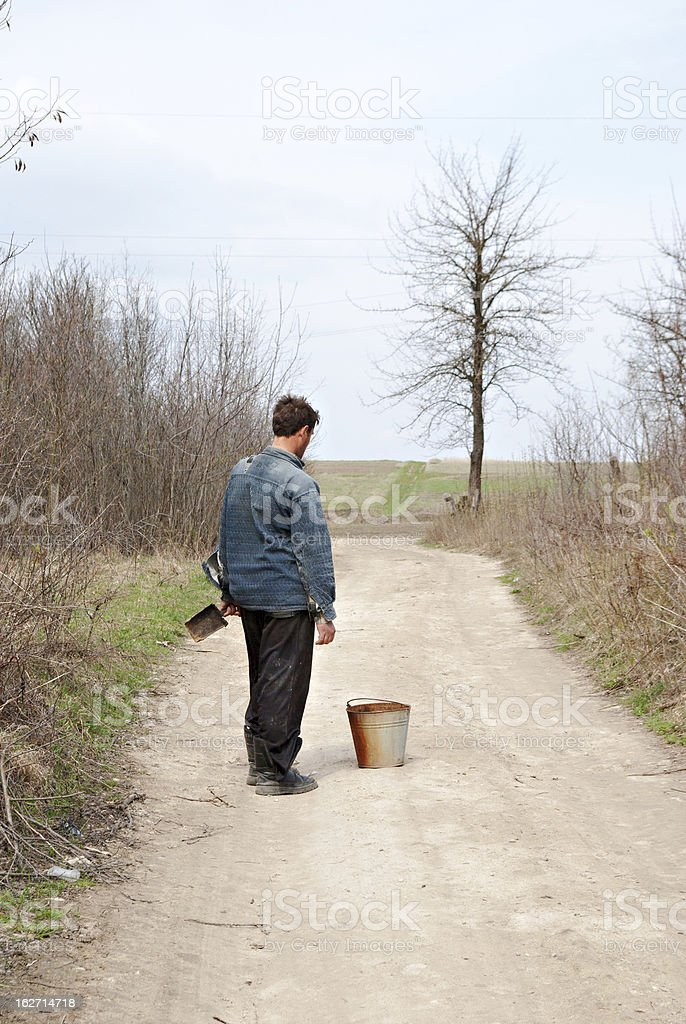 one man water carrier stand on the road stock photo