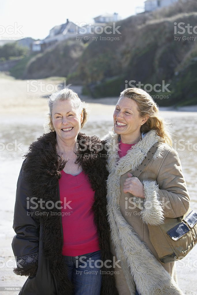 One mature and one senior woman on the beach royalty-free stock photo