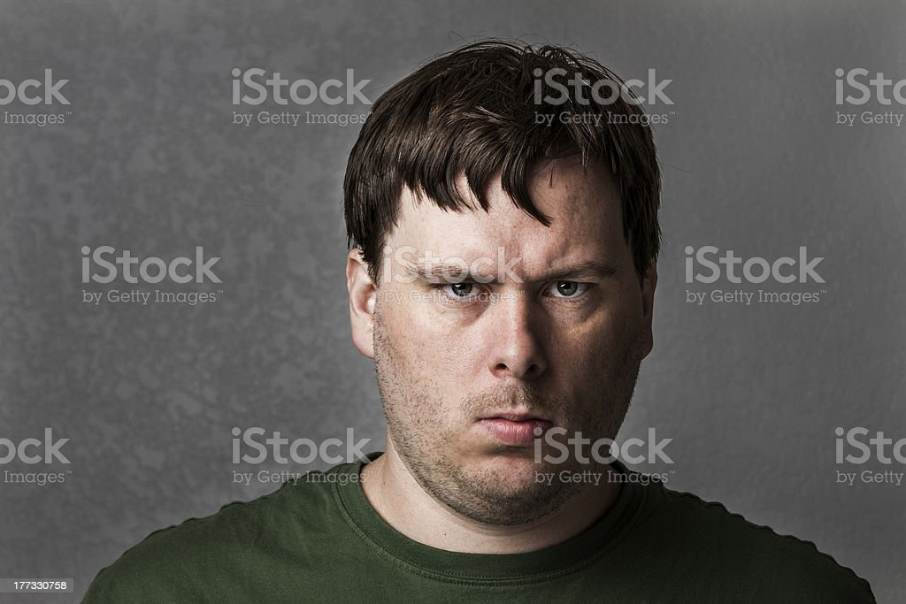 One mean looking guy about to cause problems stock photo