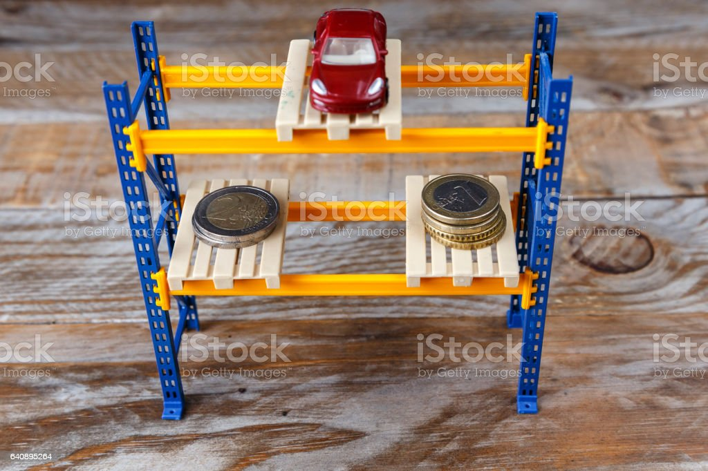 One miniature car and some coins stock photo