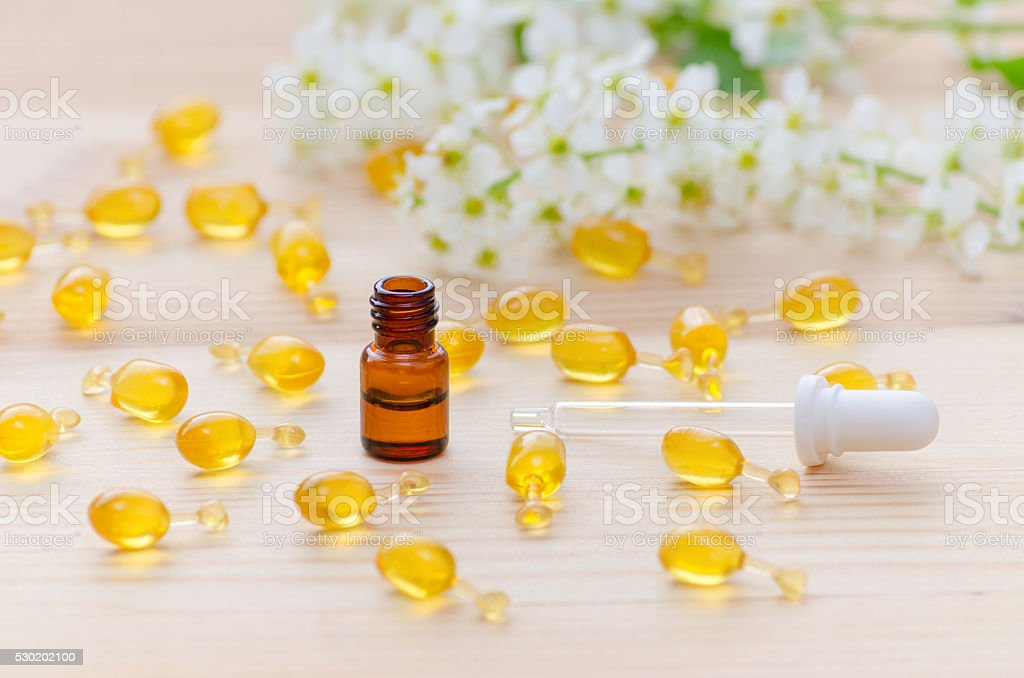 one ml brown bottle with neroli essential oils, a pipette stock photo