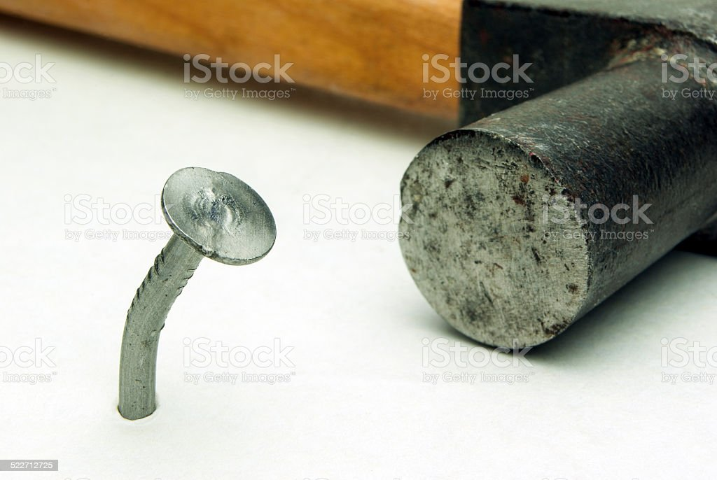 one nail and hammer royalty-free stock photo