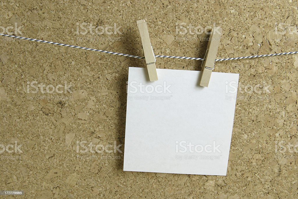 one note hanging on a tread royalty-free stock photo