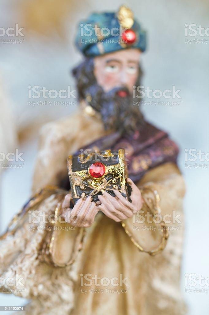 One of Magi offering gift in nativity scene stock photo
