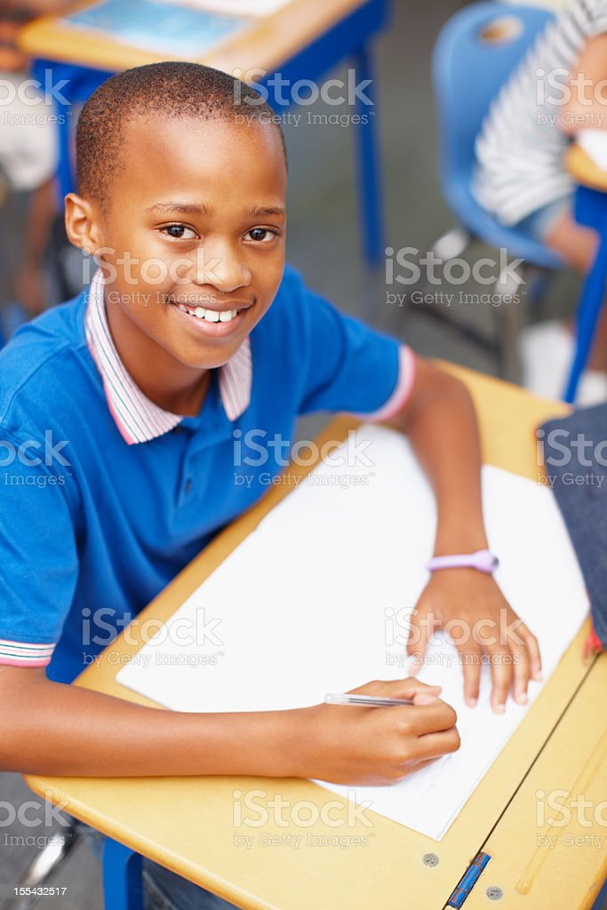 One of our brightest students, working hard as usual! stock photo