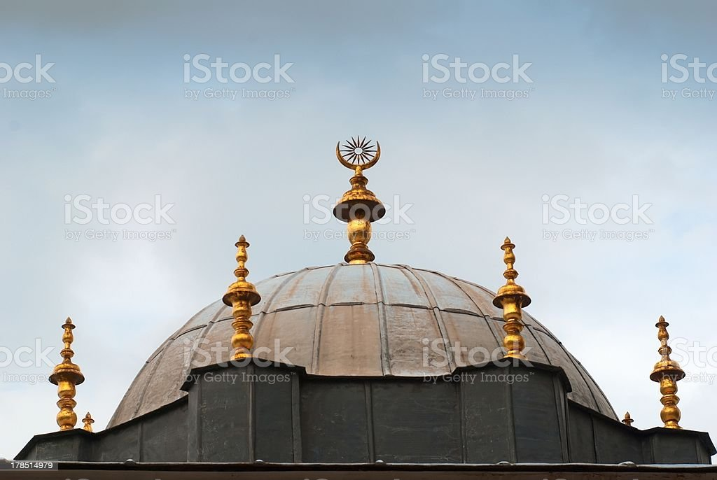 One of the building roof golden detail in Topkapi Palace stock photo