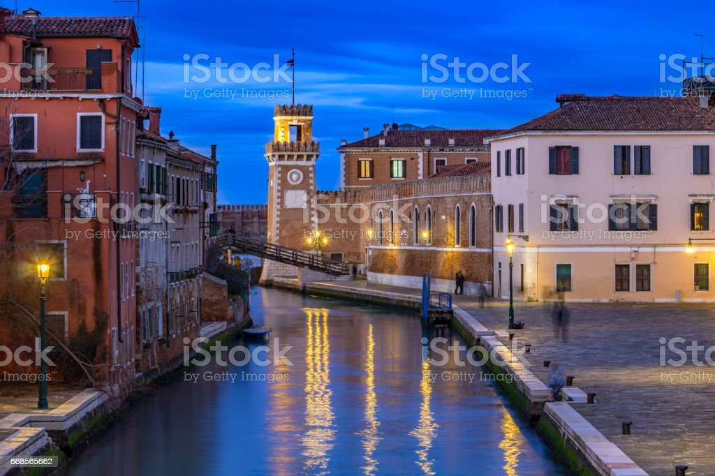 One of the canals in Venice and the Arsenal Tower in the distance. Italy, blue hour stock photo