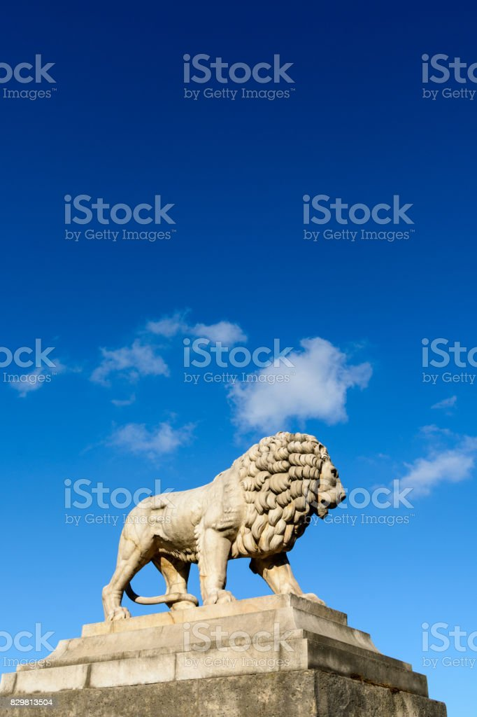 One of the two marble lions of the Tuileries garden overhanging the Concorde place in Paris stock photo