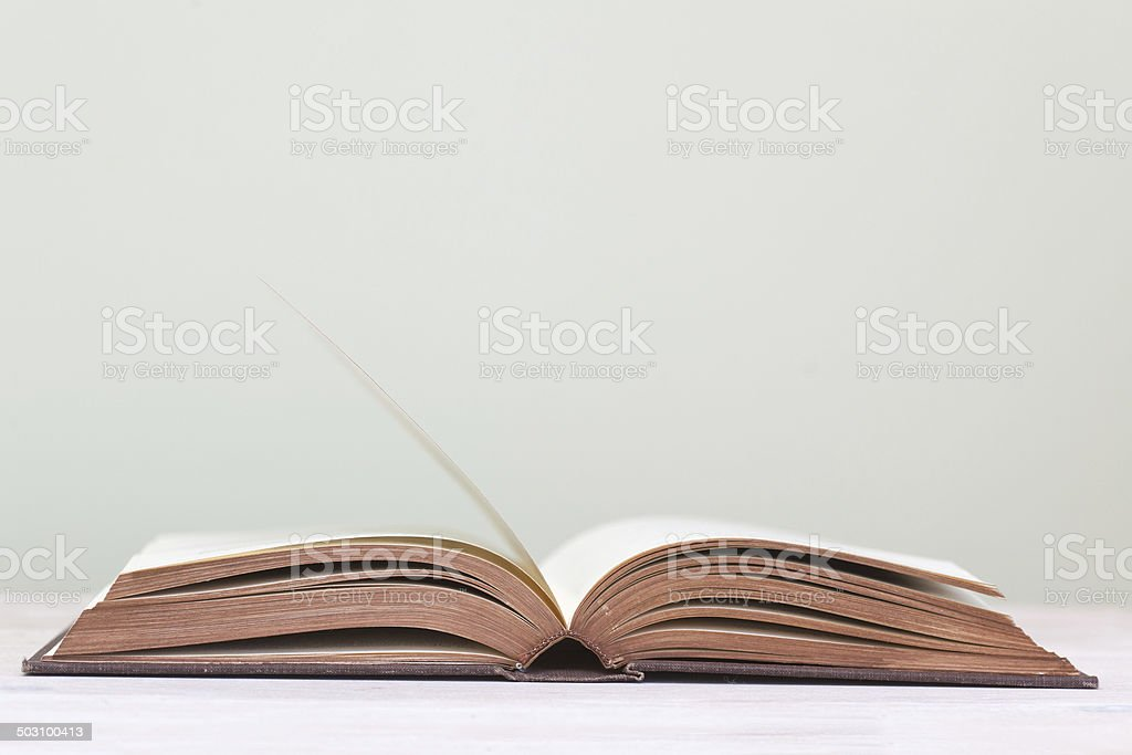 one open book lying on the table stock photo