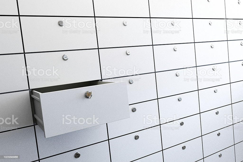 One open safety deposit box among many closed ones stock photo
