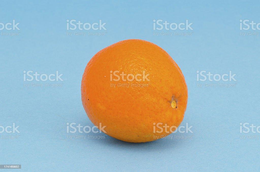 one orange on azure background stock photo